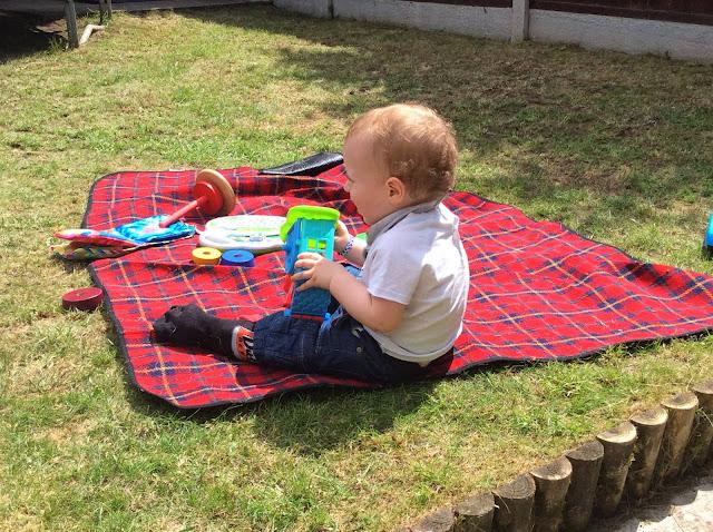 Child sat on grass