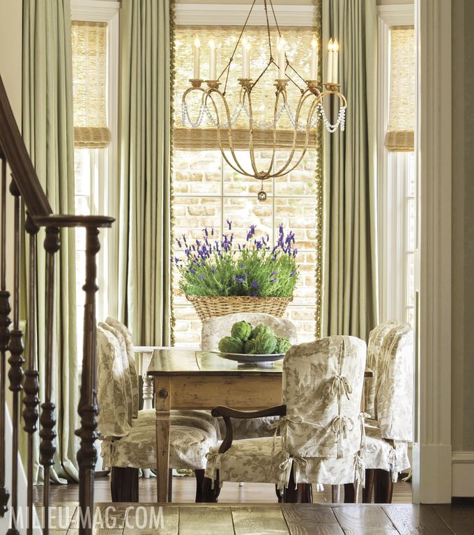 Romantic and feminine dining room with slipcovered chairs in Milieu magazine