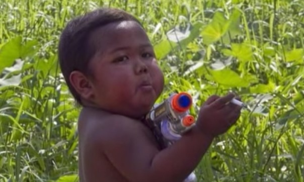 We've heard of getting a kid his first squirt gun or toy... - Remember The Chain Smoking Baby? Look At What He's Doing Now.