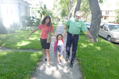Wallace and Nancy Braud escorting Grace to first day of kindergarten in Winnipeg, Manitoba