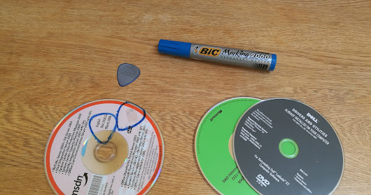 Make plastic guitar pick out of old CD or bank cards.