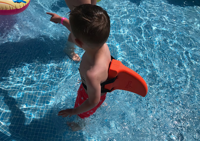 wearing a orange swimfin in the pool