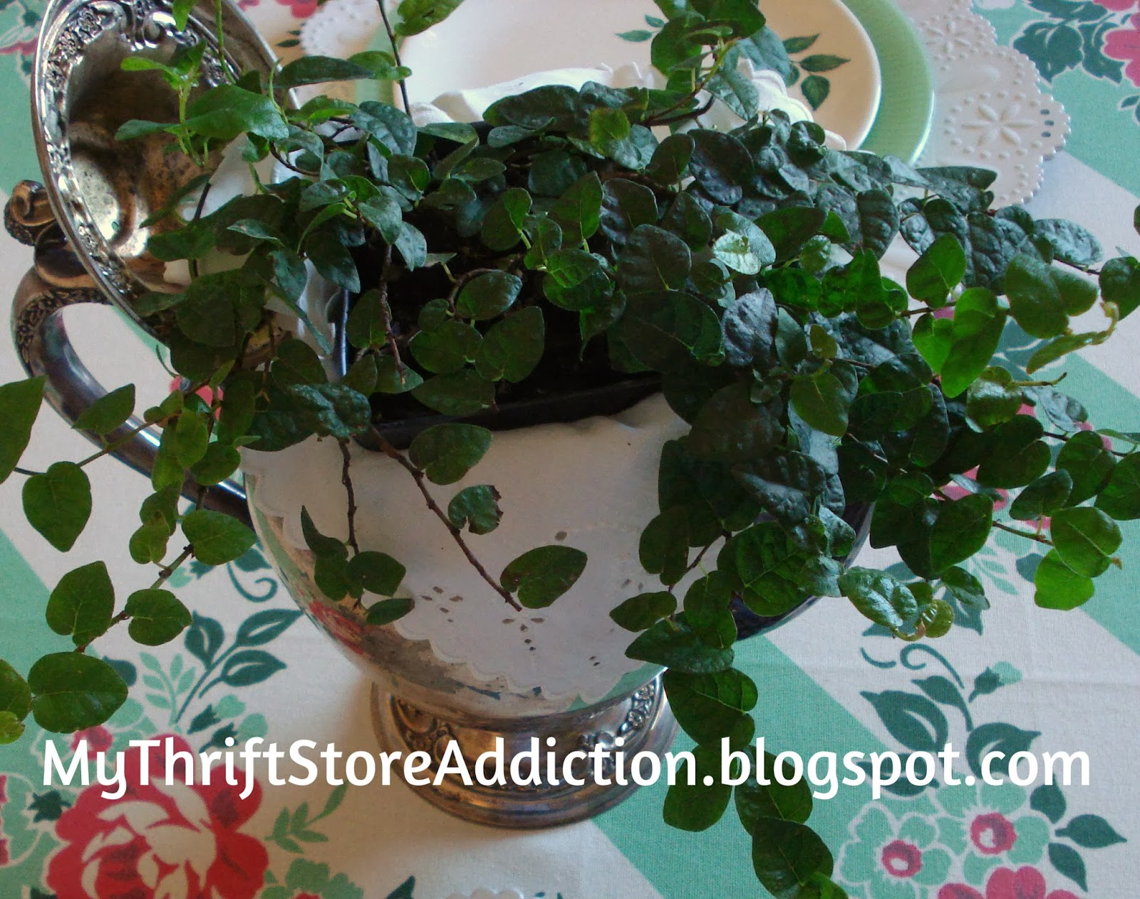 Repurposed vintage silver teapot planter