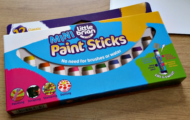 A set of coloured paint sticks in the box