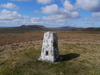 The trig point on Horse Head looking towards Penyghent and Ingleborough