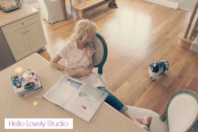 Image of mom in stylish French Country kitchen with feet up relaxing with wine - blogger Michele of Hello Lovely Studio