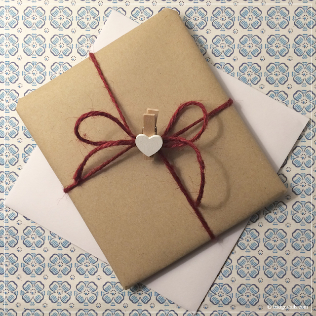 Kraft-Wrapped-Gift-Tied-with-Burgundy-Ribbon-with-White-Heart-Peg