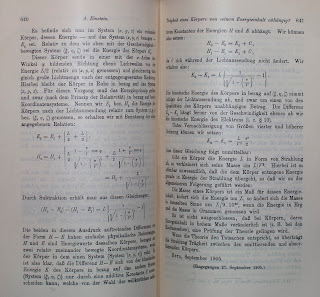 An open book of printed text and equations.