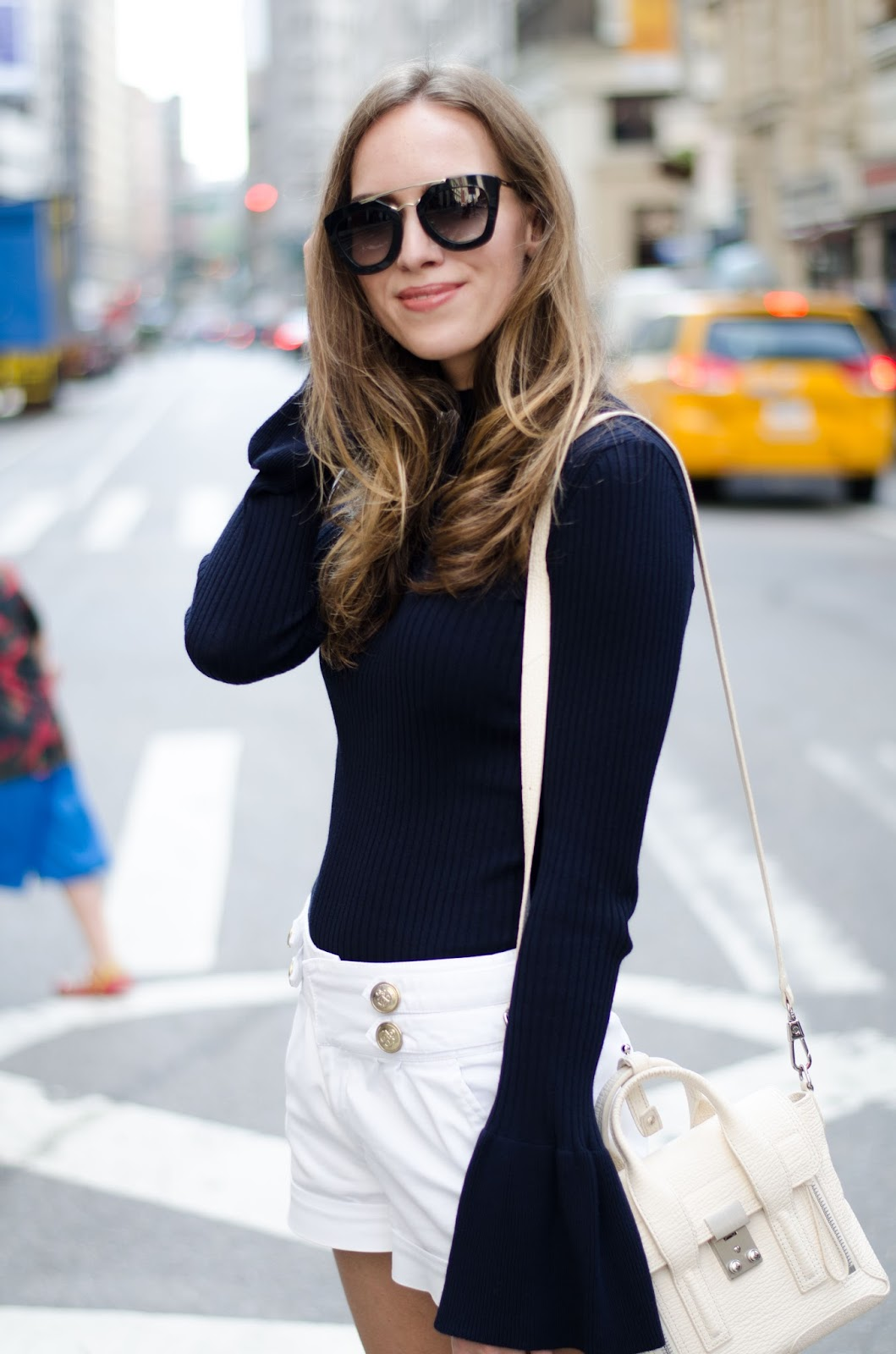 navy bell sleeve jumper white shorts outfit
