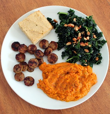 Leftovers, the freezer, and dinner: kale salad, sweet potato, chicken sausage, and jalapeno cornbread