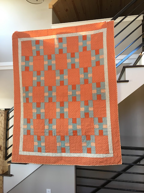 Contemporary Nine Patch quilt pattern made in orange and blues