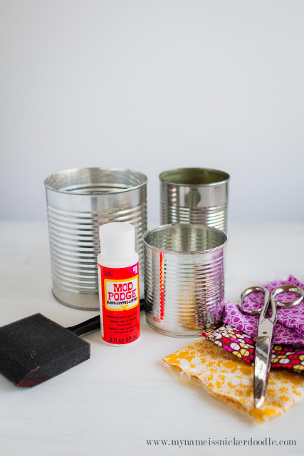 Here's and easy and inexpensive way to stay organized!  Fabric covered canisters are simply adorable and can be made in minutes!  |  mynmameissnickerdoodle.com