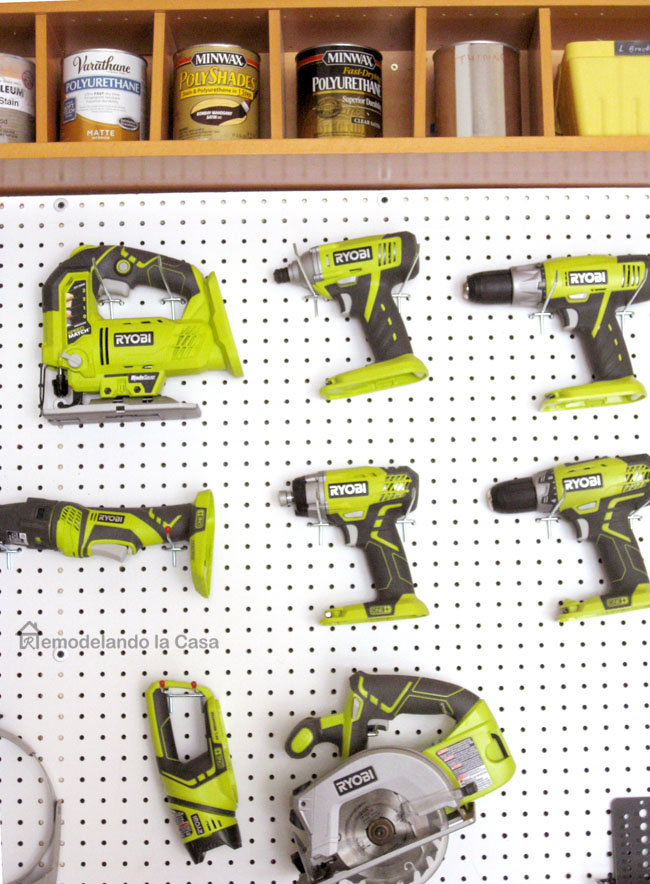 Ryobi tools on pegboard in the garage