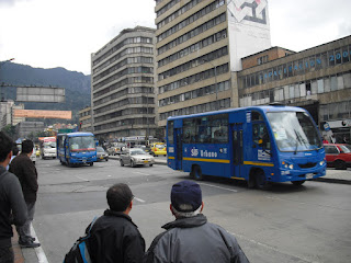 A couple of Bogotá's SITP buses, practically empty as per usual
