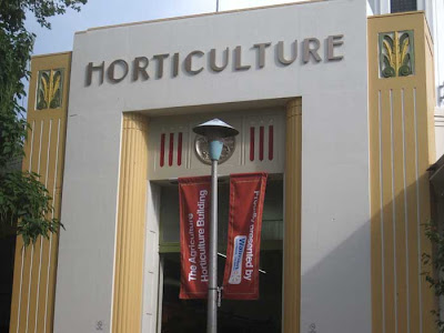 Beautiful art deco lettering for HORTICULTURE building with banner below saying Sponsored by Walmart