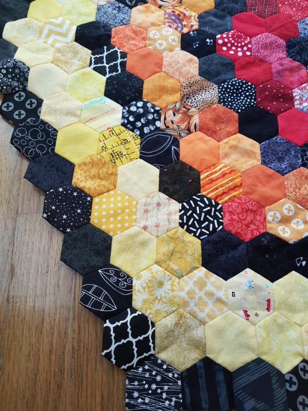 Rainbow hexie quilt | DevotedQuilter.blogspot.com