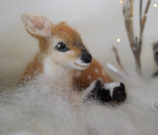 Deer Fawn with Skunk