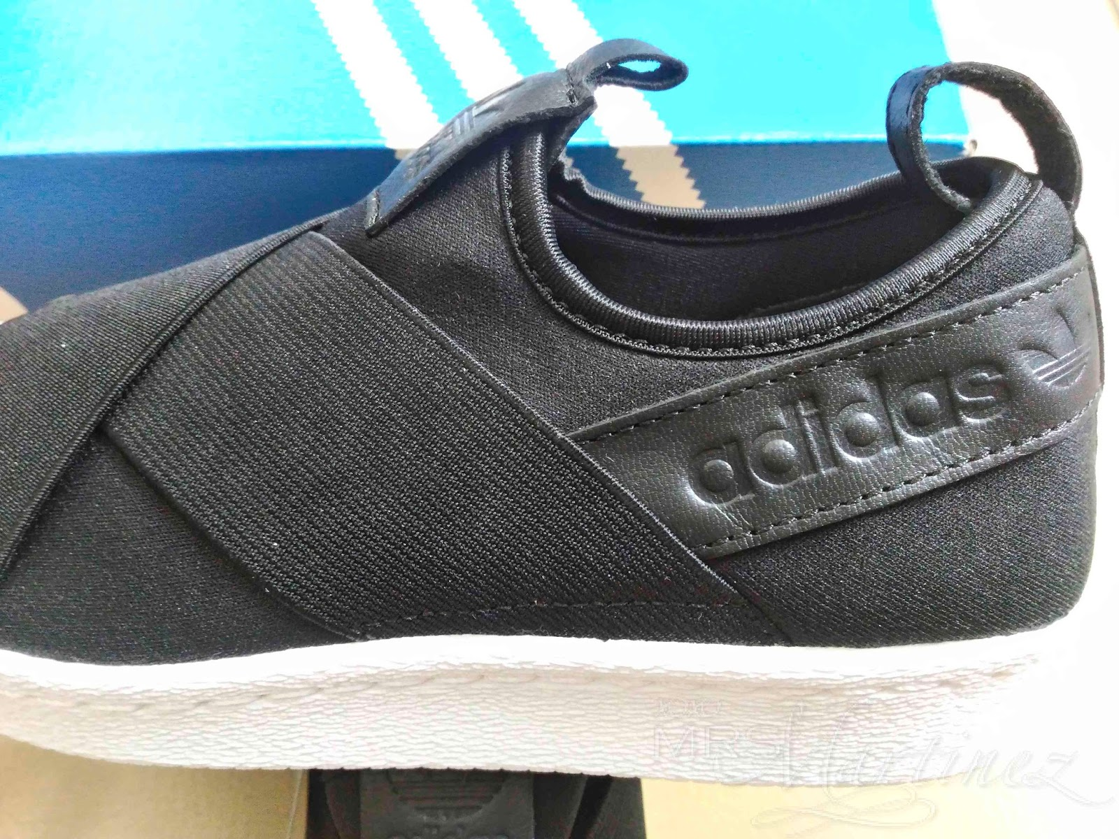Adidas Superstar logo is debossed- the imprinted design causes depressions  in the leather material leaving a depressed imprint of the image