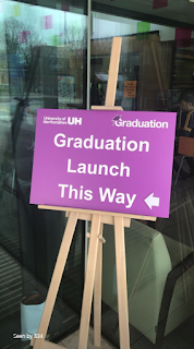 "An image from the University's Instagram Stories, featuring an easel holding a purple stand with ""Graduation launch this way"" written on it"