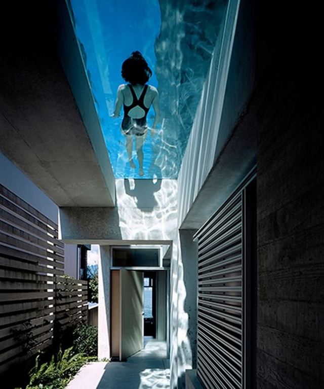 Entrance of modern home with swimming pool above