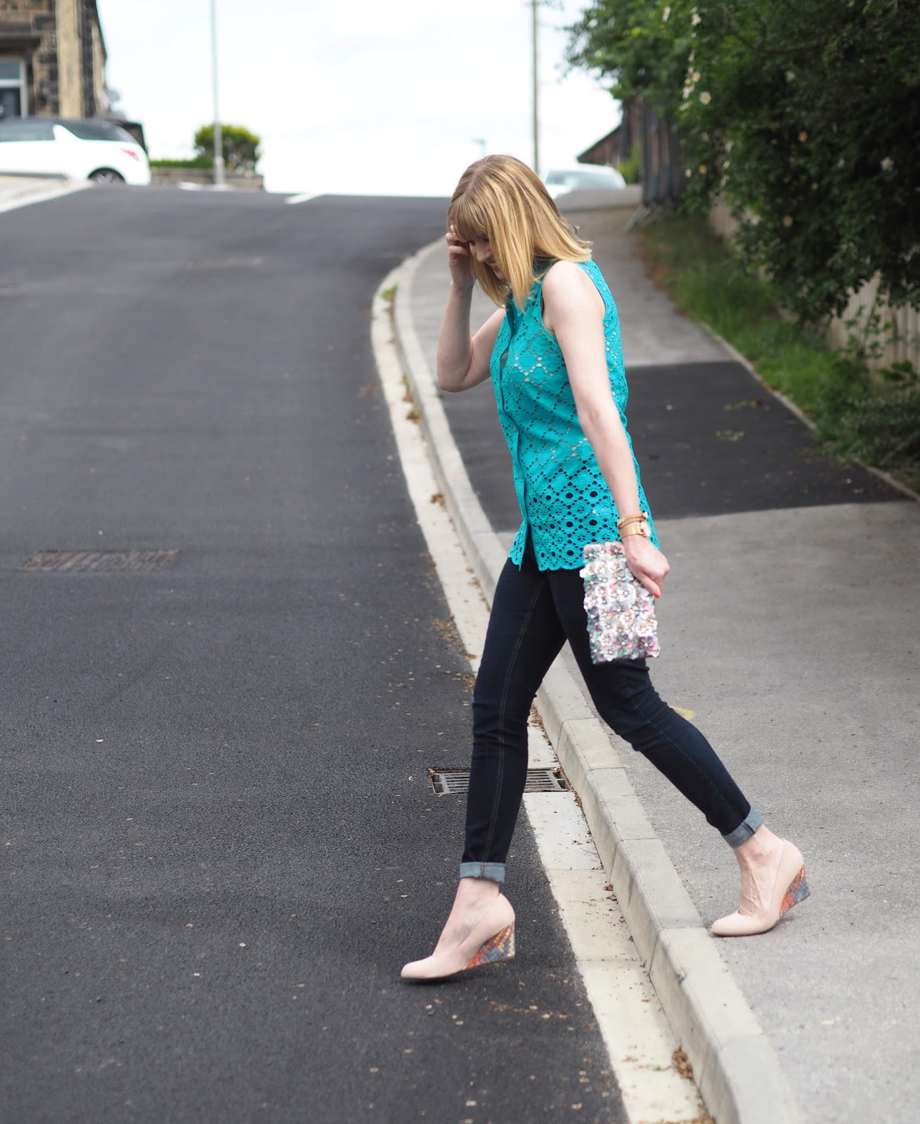 Turquoise broderie anglais top with skinny jeans and wedge shoes