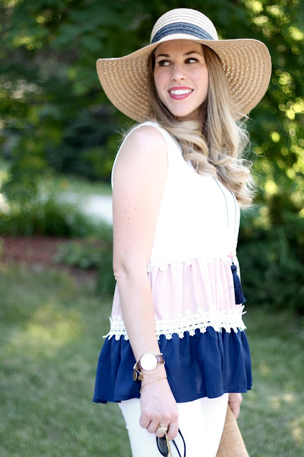 navy tan white colorblock sleeveless blouse, straw floppy hat, white jeans, wedge sandals, sunglasses, straw clutch, summer outfit, white jeans summer outfit
