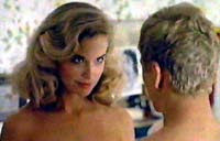 Kelly Preston look of lust before sex while topless and about to go bottomless