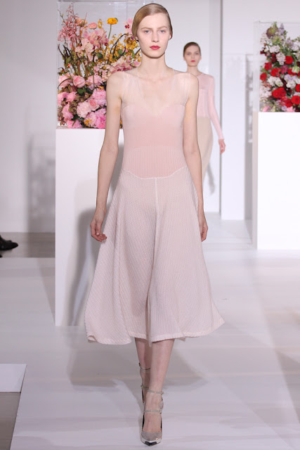 Model wearing a swingy, semi-sheer pale pink dress from Jill Sander's Fall 2012 Ready to Wear runway show