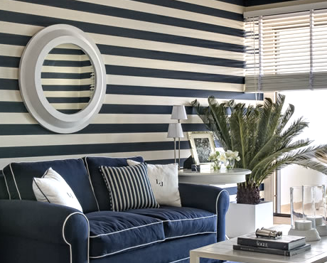 living room with blue and white horizontal wall stripes