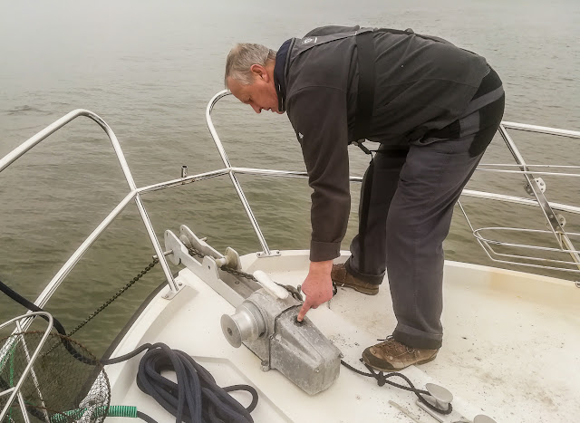 Photo of Phil weighing anchor at the end of the fishing trip