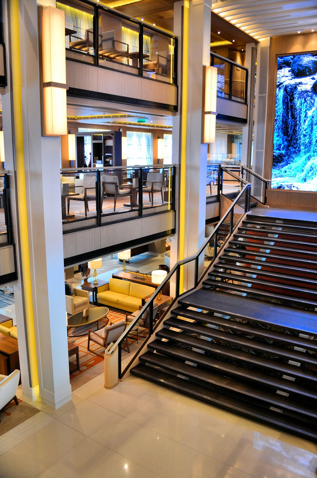 The atrium on board the Viking Ocean Cruises ships is known as the Living Room for its inviting alcoves and intimate gathering places for guests.
