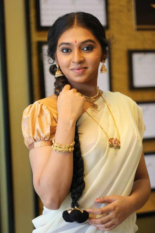 Glamours Tamil Girl Lakshmi Menon Photos In White Lahenga Voni Half Sari