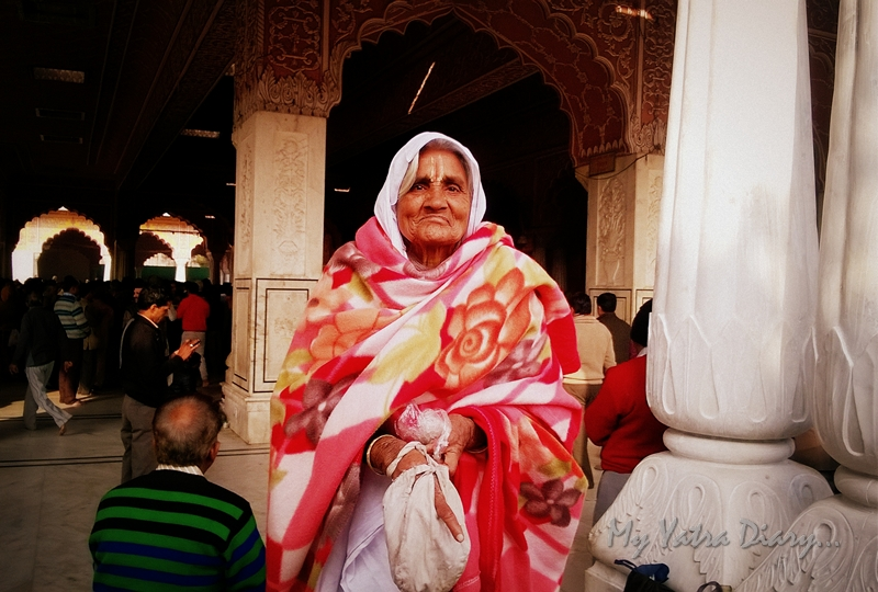 An old devout poses at the Govind Devji Temple, Jaipur, Rajasthan