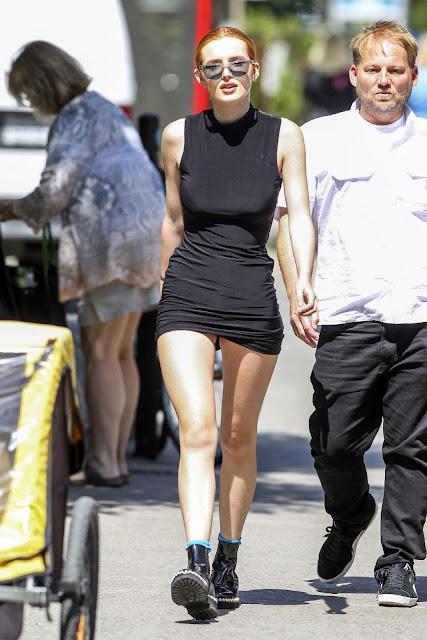 Bella Thorne in Black Mini Dress – Montreal
