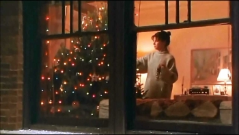 Sandra Bullock goes to a lot of trouble to get her Christmas tree into her apartment in WHILE YOU WERE SLEEPING (1995)