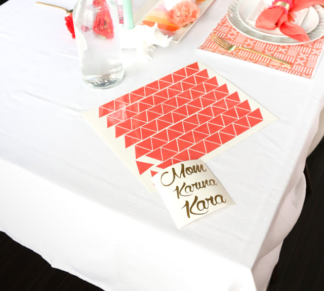 Use adhesive vinyl to deocrate your tablecloth with a temporary design to match your party theme as well as make placecards for each guest