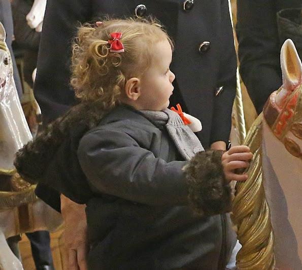 Princess Charlene, Princess Gabriella at opening the Monaco Christmas Village in Monaco. Style of Princess Charlene