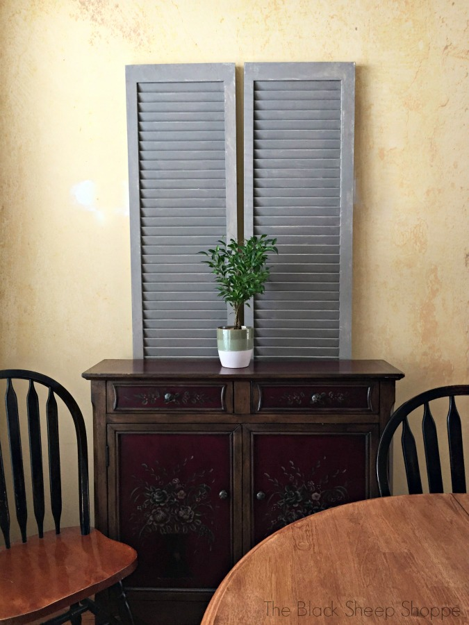 Louvered doors tucked behind a cabinet in my breakfast room.