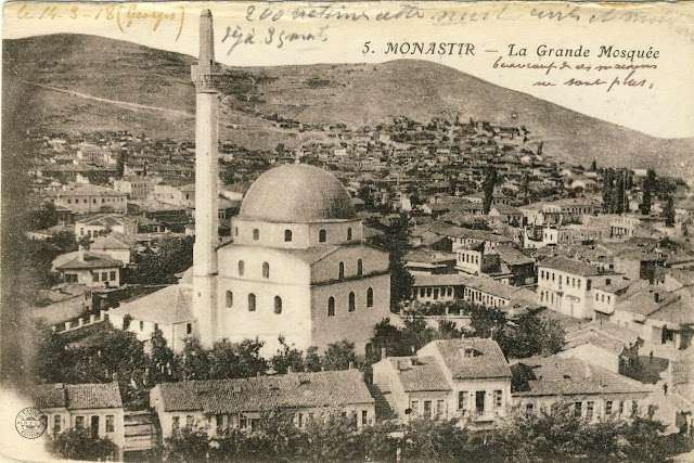 """Isac mosque with shops along the river Dragor and """"Smilevski Bair"""" in the background – photo from 1917 made from Yeni Mosque."""