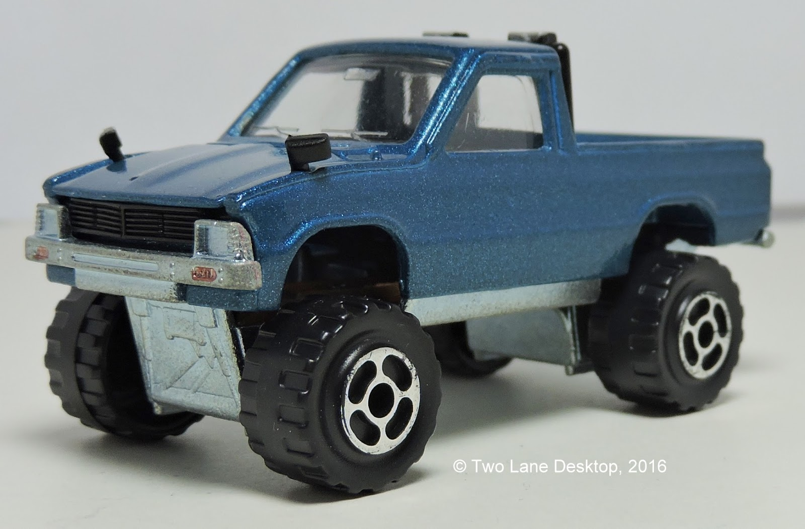 Two Lane Desktop: Majorette and Tomica 1980 Toyota Hilux's