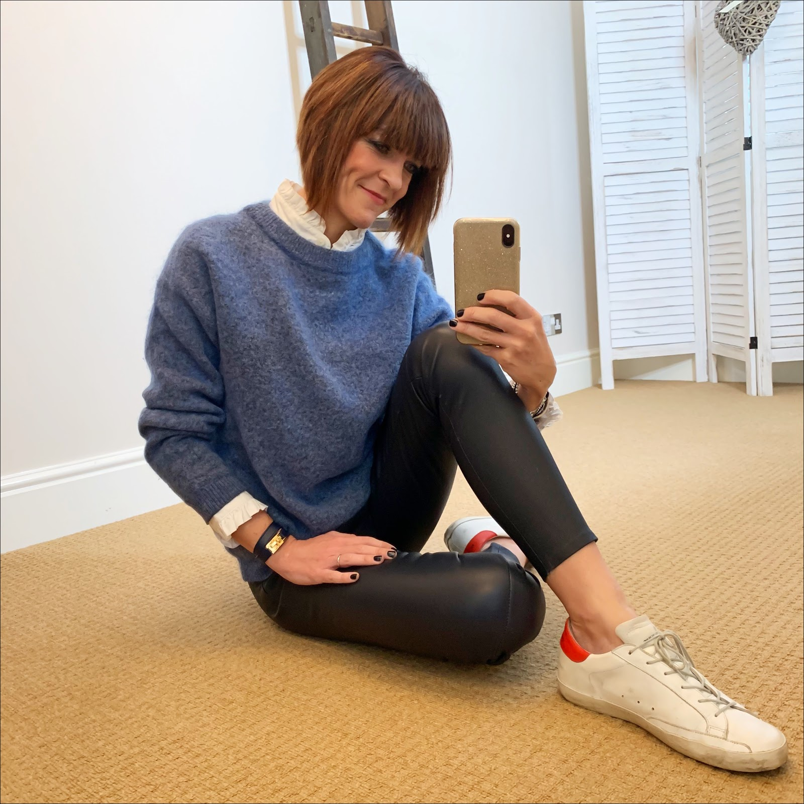 my midlife fashion, uniqlo high collar frill blouse, acne studios dramatic crew neck jumper, uterque nappa leather leggings, hermes wrap bracelet, golden goose superstar low top leather trainers