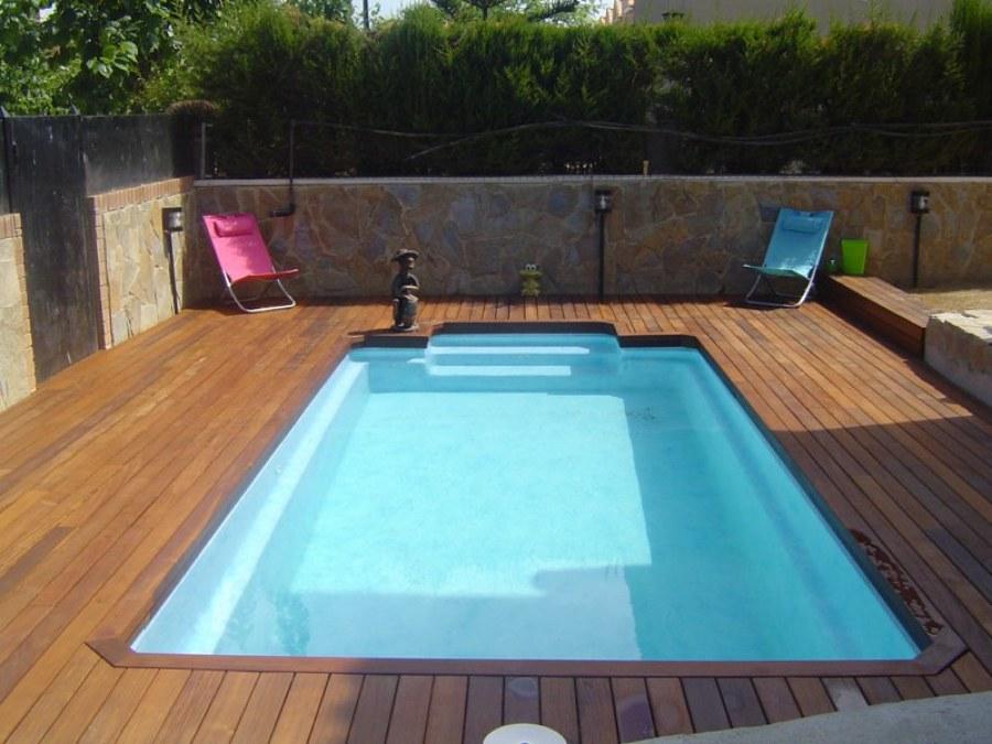 Marzua piscinas de fibra piscinas expr s for Fotos de piletas de material