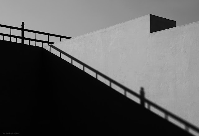 A Black and White Minimalist Photograph of the Shadow of a Metal Railing at Jantar Mantar Jaipur, India, shot via Canon 6D Mark II Camera.
