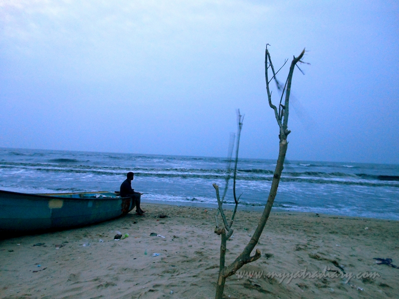 A boatman relaxing at Elliot beach, Chennai in Tamil Nadu