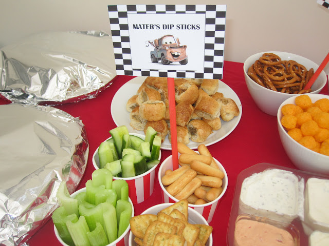 Dipping food with a sign saying Mater's Dip Sticks