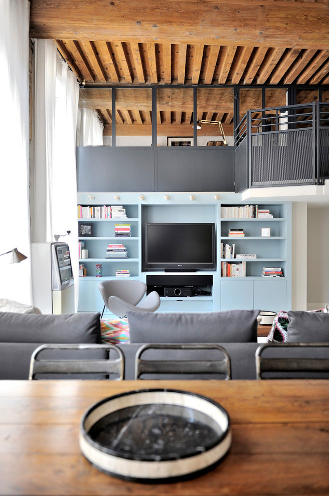 French loft with wooden beams, mid century modern furniture, white floors, colorful details
