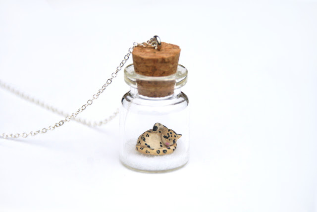 https://www.etsy.com/uk/listing/169717067/snow-leopard-jar-necklace-miniature-wild