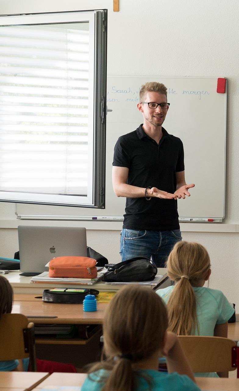 A teacher teaching a class.