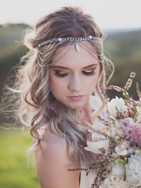 Messy wavy bride hairstyle with accessory