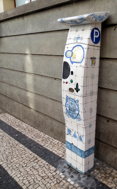 painted parking meter next to the Mercado dos Lavradores